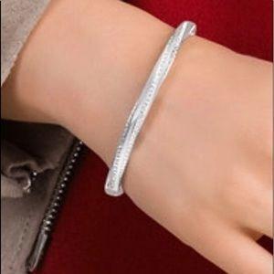 Swarovski twisted Pave crystal bangle bracelet